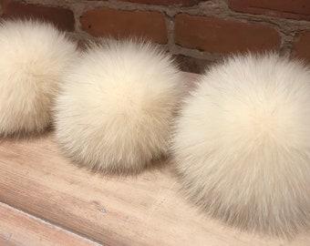 6519831559e Ivory Fox Pom Pom