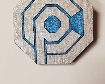 Robocop OCP Omni Consumer Products inspired pin