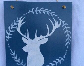 Deer silhouette on blue