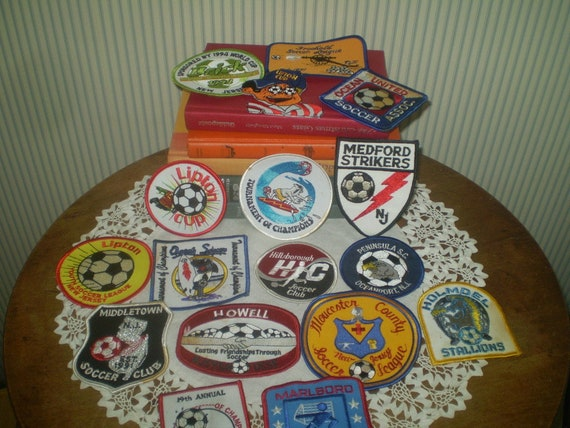 17 new, unused soccer patches- Soccer league and t