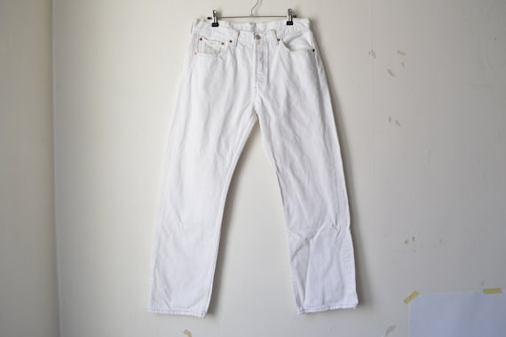 white Levi's 501 high waist straight leg buttony f