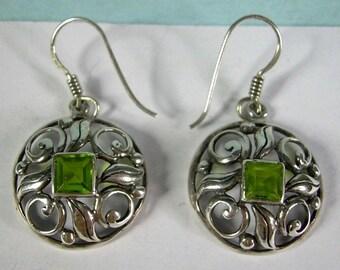 Lovely peridot look scroll work silver earrings