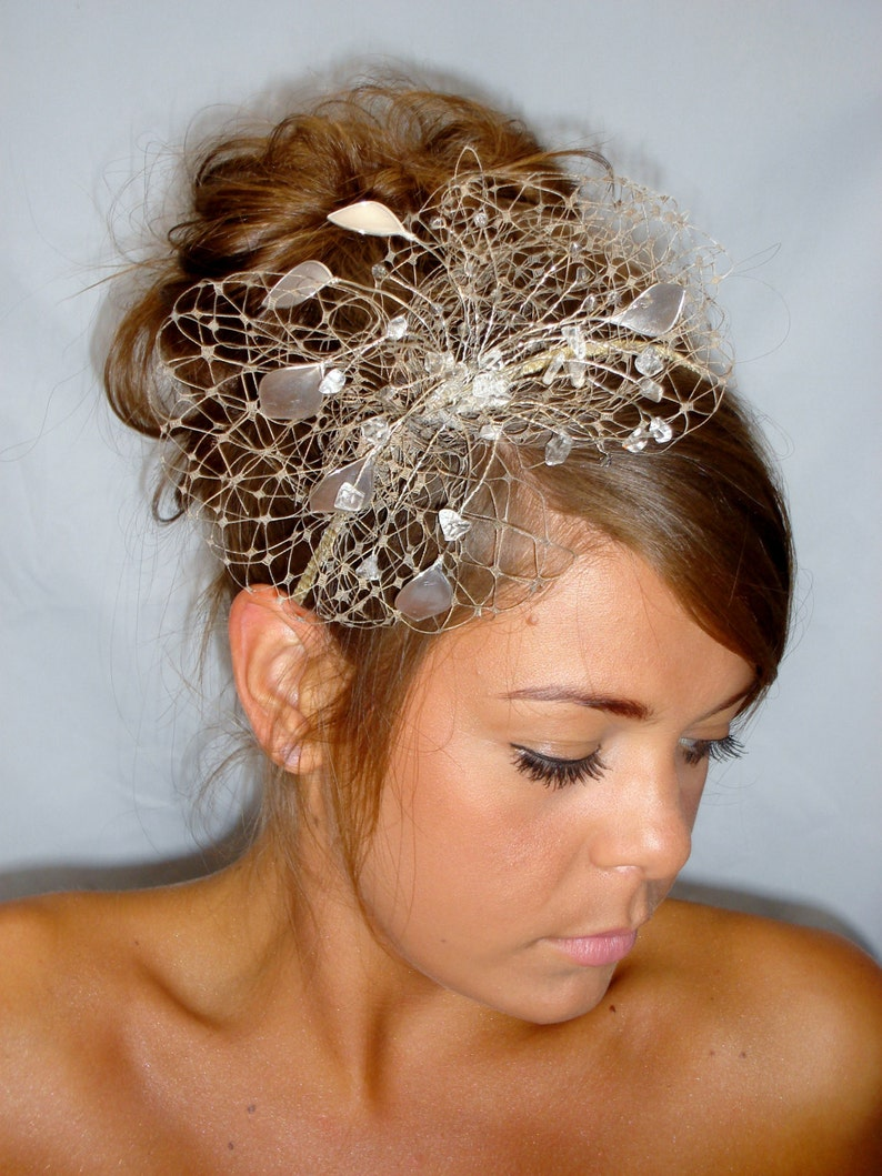 Gold fascinator mother of the bride Summer wedding wedding image 0