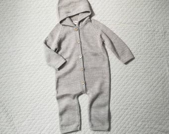 Hooded baby overall knitted in alpaca wool