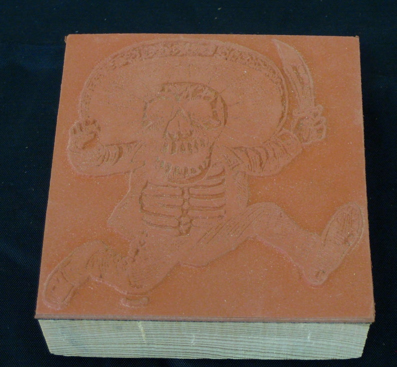 Rubber Stamp  Print Block Day of the Dead Themed Calaveras  A Man Running Mounted on Repurposed Pallet Wood