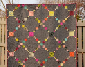 Irish Puzzle, digital quilt pattern in baby, lap, twin sizes.  Charm pack and scrap friendly design.
