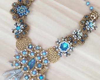 Statement beaded necklace made from Glacier Blue Swarovski Crystals and pearls, gold plated elements and gold japanese seed beads