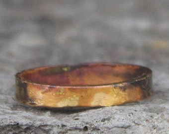 Burnt 18k gold band ring with a wabi sabi organic silhouette. Hammered + oxidized gold ring. Hand crafted.