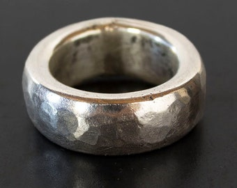 One of a kind hammered sterling silver wide band with a domed silhouette. Hand crafted. Size 6.