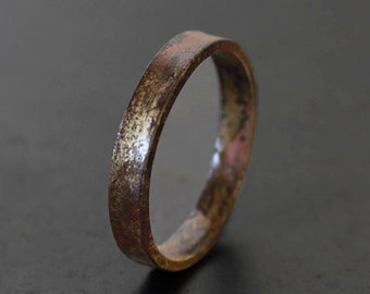 Burnt 10k gold band ring with a wabi sabi organic silhouette. Hammered + oxidized gold ring. Custom width. Hand crafted.