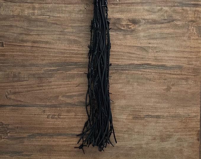 Black Rubber & Barbed Leather Flogger