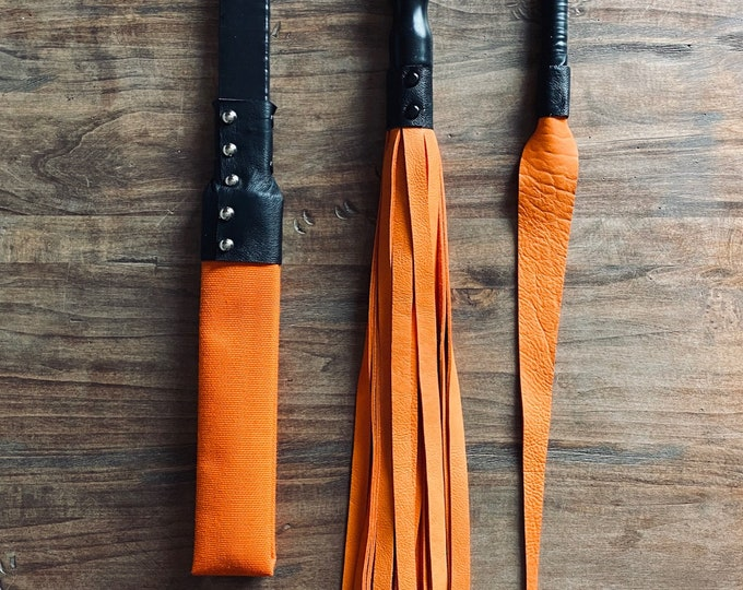 Orange Leather Flogger and Shot Loaded Fire Hose Paddle Set