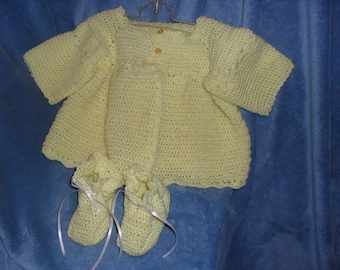 Girls 9 to 12 months light yellow sweater with booties.