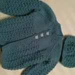 Baby cardigan with matching hat