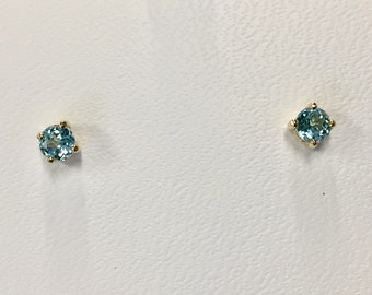 Blue Topaz 14k yellow gold 0.64 carat stud earrings