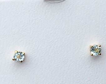 Sky Blue Topaz 14k yellow gold stud earrings