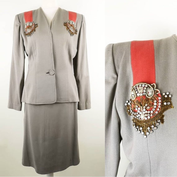 Vintage 1940s Fred A Block gray suit with coral st