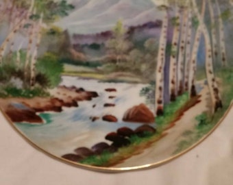 Pair of Occupied Japan Hand painted Plates. Mountains,stream,woods. Very nice.