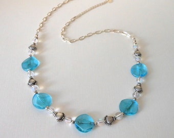 Caribbean Crystal Blue Necklace with Silver Sea Shell Accent Beads on an adjustable silver necklace.