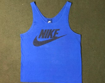 6fd65aab981b8 Vintage 80 s Nike Tank Top Swoosh Made in USA Nike Blue Tag