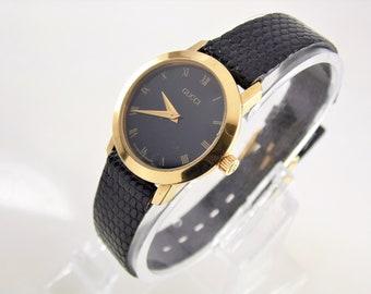 6851dbbf60f Rare Vintage Womens Ladies Black   Gold Authentic Gucci 2200L Luxury  Designer Roman Numeral Swiss Quartz Watch ETA 579.005