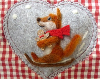 Needle felted sledging fox on a felt heart hugging his gingerbread man - scented with spices, animal enjoying the snow this Winter