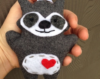 Raccoon ornament from recycled materials