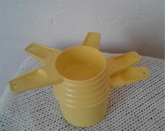 Set of Five Vintage 80s Tupperware Measuring Cups