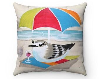 Sanderling under umbrella pillow
