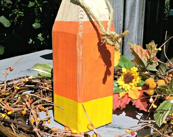 Candy corn, fall decor, halloween decor, wooden buoy, orange, yellow