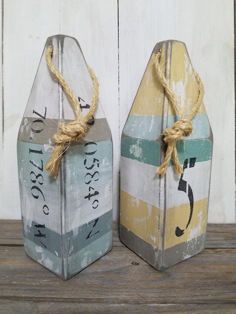 House number buoy  latitude longitude  pair of wooden buoys image 0