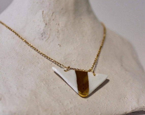 Gold white porcelain bead on gold necklace