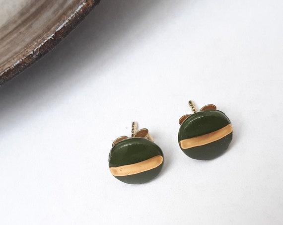 Green stuks with a golden stripe