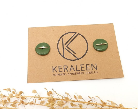 Green studs with a golden stripe