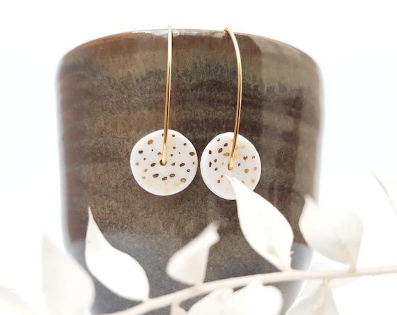 Long White golden earrings