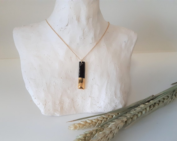 Short black gold necklace with handmade rectangle bead