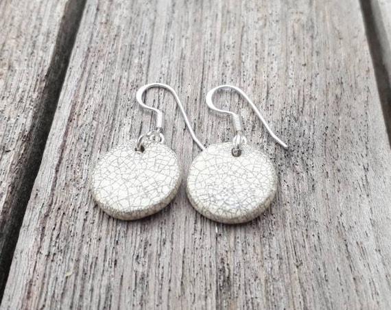 Handmade white raku black round porcelain earrings
