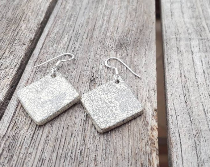 Handmade ceramic rhombic white raku black earrings