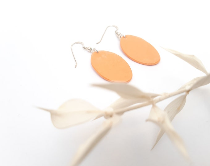 Pastel orange oval pearl on  real silver earrings