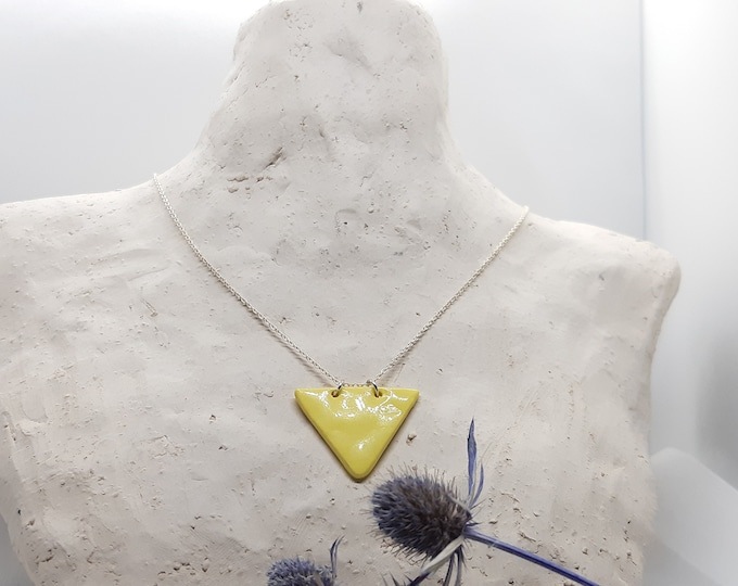 Liltle yellow porcelainbead on a real silver short necklace
