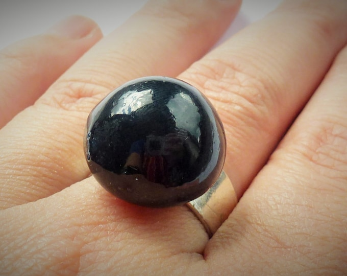 Black hemisphere ring of porcelain with silver adjustable ringbase.