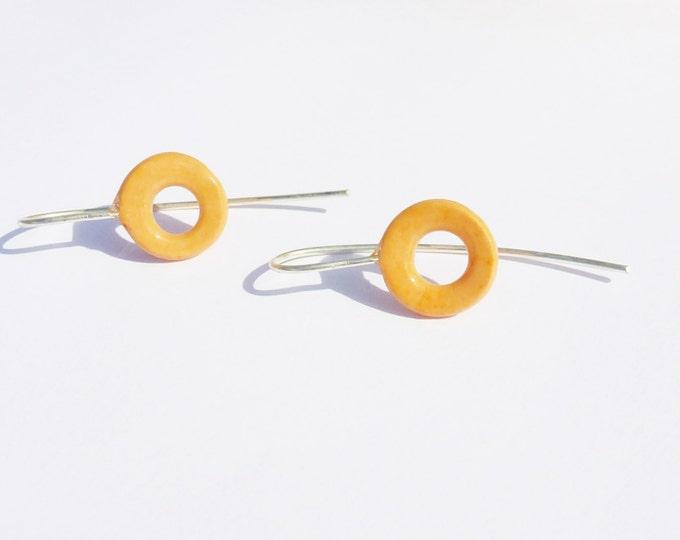 Earrings: handmade open slice bead, orange