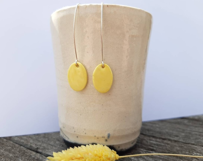 Pastel yellow oval pearl on long real silver earrings