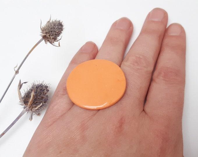 Round orange porcelain adjustable ring