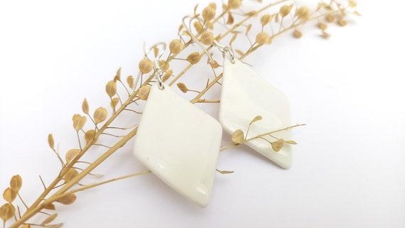 White diamond-shaped porcelain/ceramic pearls on genuine silver (AG925) earhooks