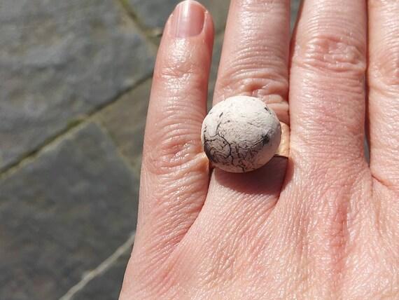 Broken white grey black light pink hemisphere ring