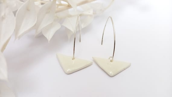 The white triangle pearl on long real silver earrings