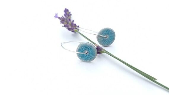 Earrings: handmade slice bead, pastel blue black crackle