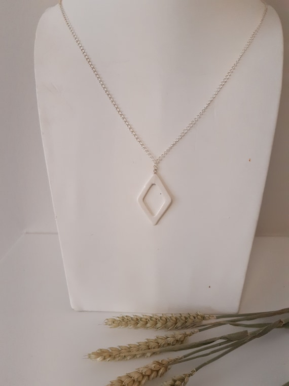 White long open diamond shaped porcelain pareal on a real silver necklace