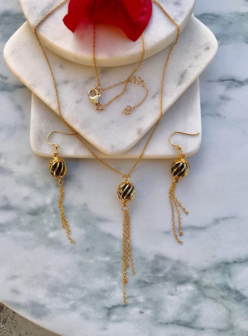 14Kt Gold Filled Necklace with Enclosed Oil Infused Lava Rocks and Tassel with Matching Earrings